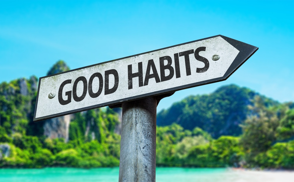 Good Habits sign with a beach on background.jpeg