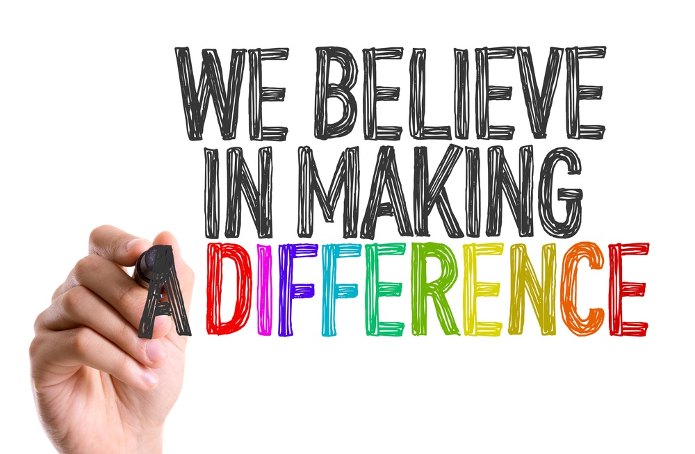 Hand with marker writing We Believe in Making a Difference.jpeg